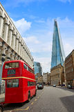 The Shard and old London red Bus Stock Photo