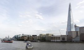 Shard skyscraper looming over the river royalty free stock photo