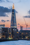 The Shard skyscraper by Renzo Piano in London. The Shard skyscraper by Renzo Piano illuminated during a deep red sunset in London on September 2, 2014 Royalty Free Stock Images