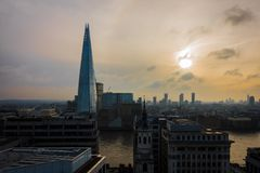 The shard with the sun in the clouds royalty free stock photography