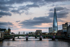 The Shard, the tallest building in London. In sunset, and the Southwark bridge Stock Image