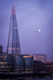 The Shard and Thames riverside with moon before sunrise stock photography