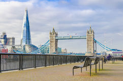 The Shard and Tower Bridge. With an empty bench in London, UK Stock Photo