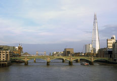 The Shard, Tower Bridge and Southwark Bridge in London 2014 at sunset. Stock Photo