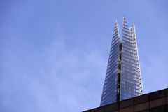 The Shard towering over a building Royalty Free Stock Photo