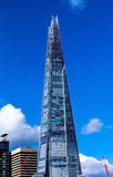 The Shard towering over London on blue sky background, UK. Royalty Free Stock Photography