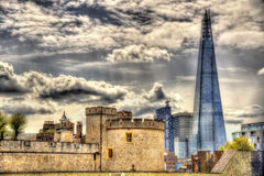The Shard and walls of the Tower of London Royalty Free Stock Photo