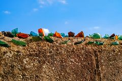 Shards of bottle glass on the fence. Close view royalty free stock images
