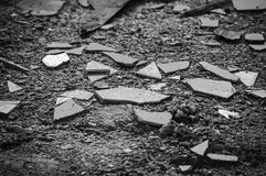 Shards of broken glass, black and white photo. Broken glass fragments, broken glass texture, black and white photo royalty free stock photography