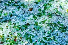 Shards of broken glass bottles. Recycling. Abstract background stock photos