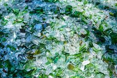 Shards of broken glass bottles. Recycling. Abstract background royalty free stock images