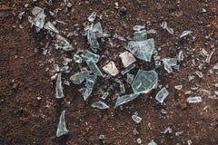 Shards of broken glass on dirty floor.  stock photo