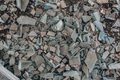 Shards of broken glass on dirty floor.  stock image