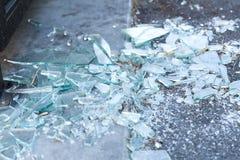 Shards of broken glass on floor. Damage concept - shards of broken glass on floor stock image