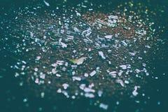 Shards of car glass on the asphalt. Sharp shards of car glass on the asphalt after car accident stock image