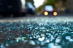 Shards of car glass on the street. Sharp shards of car glass on the asphalt stock image