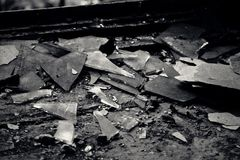 Shards of glass in abandoned house. Many shards of glass in the house Royalty Free Stock Photos