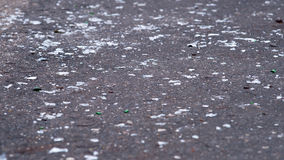 Shards of glass on the road. Shards of glass on the old asphalt road royalty free stock photography