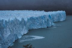 Shards of ice calving off the face of a glacier royalty free stock photography