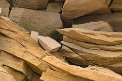Shards of rock. Osklkki rocks in the form of a stone wall stock image