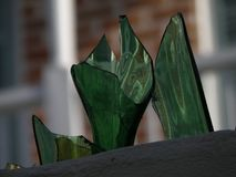 Shards of sharp adorn a wall for security. Shards of glass adorn the wall in the French Quarter in New Orleans, Louisiana. The are use to deter people from stock photo