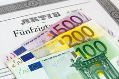 Share with Euro banknotes Royalty Free Stock Images