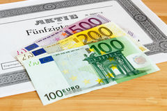 Share with Euro banknotes Stock Image