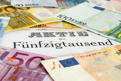 Share with Euro banknotes Royalty Free Stock Photo