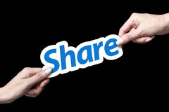 Share icon. Hand giving share icon to another person Royalty Free Stock Photo