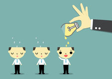 Share idea. Big hand carry lightbulb glass and pouring liquid on one businessman's head Stock Photos