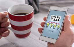 Share ideas concept on a smartphone Stock Photography