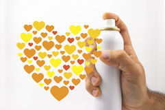 Share the love. Spray can and hearts in white background Stock Photography