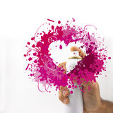 Share the love. Spray can and hearts in white background Stock Photos