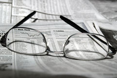 Share market study. Eye glasses on newspaper stock listings Royalty Free Stock Photos