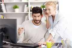 Share the music at the office Royalty Free Stock Image