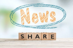 Share news word sign on a table. Share news word sign on a wooden table Stock Photo