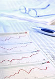 Share prices. Charts and tables with share prices royalty free stock image