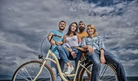 Share or rental bike service. Group friends hang out with bicycle. Bicycle as best friend. Company stylish young people. Spend leisure outdoors sky background stock images
