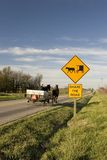 Share the road. An Amish team & wagon passing a related share the road sign Royalty Free Stock Photo