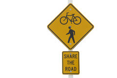 Share the road sign. With image of stick figure pedestrian and bicycle on a square yellow orange sign  on white background horizontal presentation Stock Images