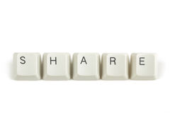 Share from scattered keyboard keys on white Stock Photo