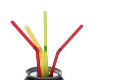 Share And Share Alike. Four colorful drinking straws in a beverage can, white isolation Royalty Free Stock Image