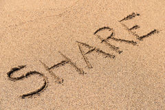 Share Sign On Beach Stock Images