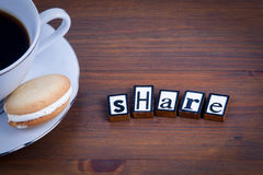 Share text on a wooden background Stock Photo
