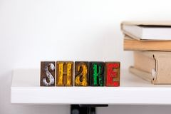 Share word from colored wooden letters stock images