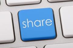 Share word on keyboard. Share word written on computer keyboard Stock Photos