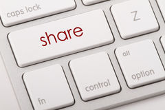 Share word on keyboard. Stock Photos