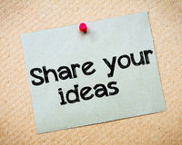 Share your ideas. Message. Recycled paper note pinned on cork board. Concept Image Stock Photography