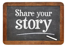 Share your story advice blackboard sign. Share your story sign - white chalk text on a vintage slate blackboard isolated on white Royalty Free Stock Photo