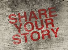 Share your story. Concept text is painted on old fashion wall Royalty Free Stock Photo